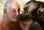 Rio de Janeiro, Brazil. Train robber Ronnie Biggs relaxing with his dog by the pool at his home in Santa Tereza in 1990.