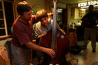 Friends get together for an informal jam session on Sunday night.