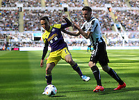 Pictured L-R: Leon Britton of Swansea against Mathieu Debuchy of Newcastle. Saturday 19 April 2014<br /> Re: Barclay's Premier League, Newcastle United v Swansea City FC at St James Park, Newcastle, UK.