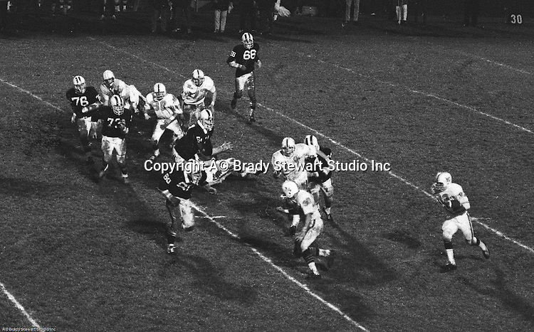 Bethel Park PA: Jet left on set with Chip Huggins 32 running around left end after excellent blocks from Bruce Evanovich 80, Glenn Eisaman 71, and Clark Miller 30. Others in the photo; Jim Dingeldine 73, Mike Stewart 11.  The Bethel Park offense and defense played very well in the 16-0 shut-out of the Upper St Clair Panthers.  The defensive unit was one of the best in Bethel Park history only allowing a little over 7 points a game.