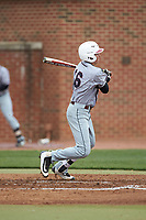 Andrew Valichka (16) of the North Carolina Central Eagles follows through on his swing against the High Point Panthers at Williard Stadium on February 28, 2017 in High Point, North Carolina. The Eagles defeated the Panthers 11-5. (Brian Westerholt/Four Seam Images)