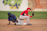 Orem Owlz second baseman Justin Jones (33) shows the ball after applying the tag to Brandon Leyton (12) on a stolen base attempt during a Pioneer League game against the Missoula Osprey at Ogren Park Allegiance Field on August 19, 2018 in Missoula, Montana. The Missoula Osprey defeated the Orem Owlz by a score of 8-0. (Zachary Lucy/Four Seam Images)