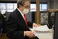 Jim Parsons holds his stack of signatures as he files for a position in the Bentonville School Board, Thursday, July 30, 2020 at the Benton County Administration Building in Bentonville. Thursday was the second day of filing for office in Benton County. Check out nwaonline.com/200731Daily/ for today's photo gallery. <br /> (NWA Democrat-Gazette/Charlie Kaijo)