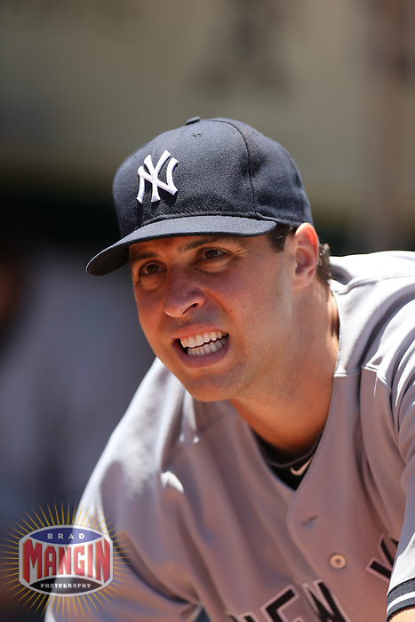 OAKLAND, CA - JUNE 13:  Mark Teixeira #25 of the New York Yankees gets ready in the dugout before the game against the Oakland Athletics at O.co Coliseum on Thursday June 13, 2013 in Oakland, California. Photo by Brad Mangin