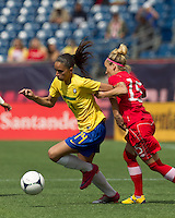 Brazilian defender Rafaelle Sousa (14) dribbles as Canadian midfielder Kelly Parker (15) defends. In an international friendly, Canada defeated Brasil, 2-1, at Gillette Stadium on March 24, 2012.