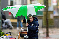 "Monday  21 November 2014<br /> Pictured: A man struggles with an umbrella<br /> Re: A yellow ""be aware"" weather warning has been issued as widespread heavy rain hits the country. The Met Office said gusts of winds could hit 50mph (80km/h) with localised flooding and disruption to travel."