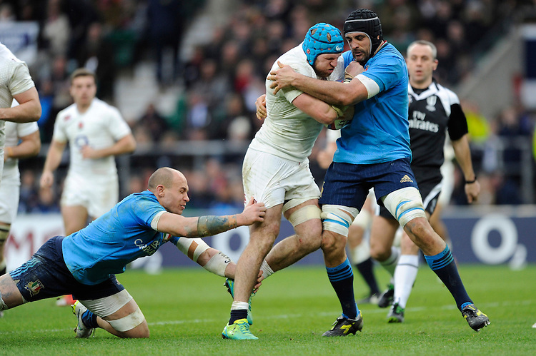 James Haskell of England is tackled by Marco Bortolami (r) and Sergio Parisse of Italy during the RBS 6 Nations match between England and Italy at Twickenham Stadium on Saturday 14th February 2015 (Photo by Rob Munro)