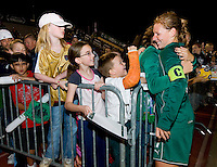 St. Louis Athletica midfielder Lori Chalupny (17) hugs a fan after their WPS match against FC Gold Pride at Korte Stadium, in St. Louis, MO, May 9 2009. St. Louis Athletica won the match 1-0.