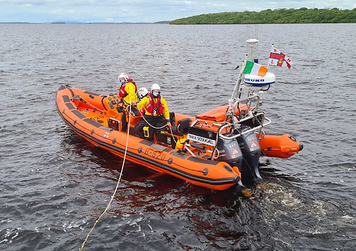 Lough Ree RNLI's volunteer crew with a tow line attached to their inshore lifeboat