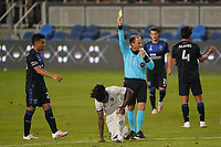 SAN JOSE, CA - SEPTEMBER 5: Referee Kevin Stott issues a yellow card during a game between Colorado Rapids and San Jose Earthquakes at Earthquakes Stadium on September 5, 2020 in San Jose, California.