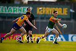 Eoghan Collins, Clare, in action against Paudie Clifford, Kerry, during the Munster Football Championship game between Kerry and Clare at Fitzgerald Stadium, Killarney on Saturday.