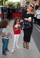 June 24, PARIS, FRANCE : Singer Maria Carey leaves the Plaza Athenee Hotel on Avenue Montaigne with children Moroccan Scott Cannon and Monroe Cannon