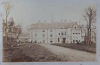 A faded photograph of Inwood house at winter time, seemingly before the large brick tower was added