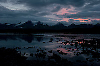 No darkness at midnight as storm clouds begin to pour over the Alaska Range on Clearwater Creek.