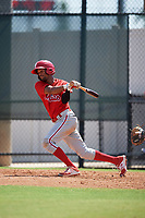 Philadelphia Phillies Jesus Alastre (31) follows through on a swing a Florida Instructional League game against the Atlanta Braves on October 5, 2018 at the Carpenter Complex in Clearwater, Florida.  (Mike Janes/Four Seam Images)