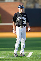 Wake Forest Demon Deacons head coach Tom Walter #32 coaches third base during the Atlantic Coast Conference game against the Miami Hurricanes at Gene Hooks Field on March 19, 2011 in Winston-Salem, North Carolina.  Photo by Brian Westerholt / Four Seam Images