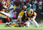Green Bay Packers receiver Jordy Nelson, center, flips at the end of a catch between Washington Redskins London Fletcher, left, and LaRon Landry during the fourth quarter of the game at FedEx Field in Landover, Md., on Oct. 10, 2010.