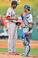 Southern Divisions pitcher Denyi Reyes (41) of the Greenville Drive and catcher MJ Melendez (7) of the Lexington Legends go over signals during the South Atlantic League All Star Game at First National Bank Field on June 19, 2018 in Greensboro, North Carolina. The game Southern Division defeated the Northern Division 9-5. (Tony Farlow/Four Seam Images)