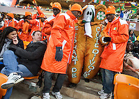 """Two Ivory Coast supporters help the """"Elephant of Ivory Coast""""  to his seat at Soccer City before the FIFA World Cup first round match between Ivory Coast and Brazil at Soccer City in Johannesburg, South Africa on Sunday, June 20, 2010."""
