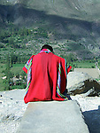 Man in Perucian dress at Incan hillside fortress at the town of Ollantaytambo in the Sacred Valley of the Incas (Peru).