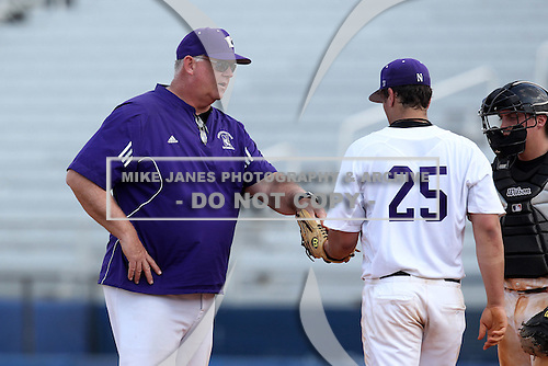 Northwestern Wildcats pitching coach Tim Stoddard #49, a former major league pitcher, hands the ball to pitcher Jack Havey #25 during a game against North Dakota State at Chain of Lakes Park on March 20, 2011 in Winter Haven, Florida.  Photo By Mike Janes/Four Seam Images