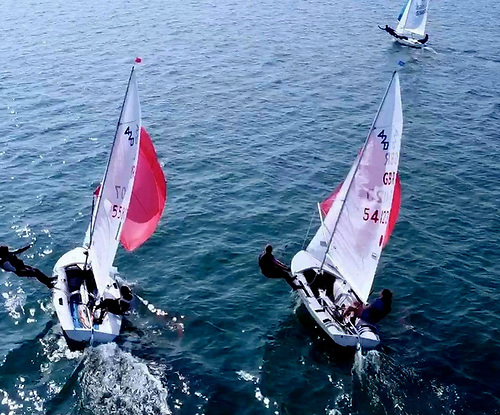 Loving the sunshine and making the best of the light breeze – Alex Leech and Conor Paul of Lough Ree YC (left, sixth overall) and Matthew Fallon & Jenny Paul (LRYC, 13th overall) in a private battle at Howth