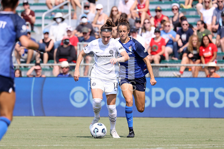 CARY, NC - SEPTEMBER 12: Natalia Kuikka #14 of the Portland Thorns FC is chased by Havana Solaun #19 of the North Carolina Courage during a game between Portland Thorns FC and North Carolina Courage at Sahlen's Stadium at WakeMed Soccer Park on September 12, 2021 in Cary, North Carolina.