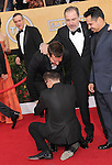 Bradley Cooper has a stranger come and grab him by the legs not letting go at The 20th SAG Awards held at The Shrine Auditorium in Los Angeles, California on January 18,2014                                                                               © 2014 Hollywood Press Agency