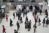 Passengers arriving at Waterloo station from London underground lines