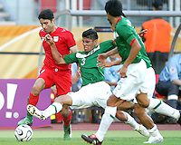 Carlos Salcido of Mexico crashes against Yahya Golmohammadi of Iran. Mexico defeated Iran 3-1 during a World Cup Group D match at Franken-Stadion, Nurenberg, Germany on Sunday June 11, 2006.