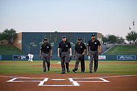 (From left to right) Umpires Malachi Moore, Junior Valentine, Erich Bacchus, and Jose Navas walk toward home plate before an Arizona Fall League game between the Glendale Desert Dogs and Scottsdale Scorpions on September 20, 2019 at Salt River Fields at Talking Stick in Scottsdale, Arizona. Scottsdale defeated Glendale 3-2. (Zachary Lucy/Four Seam Images)