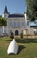 The chateau building with its twin towers and on the lawn in the garden a sculpture of a gigantic bottle of wine symbolising the wine production  Chateau Caillou, Grand Cru Classe, Barsac, Sauternes, Bordeaux, Aquitaine, Gironde, France, Europe
