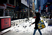 NEW YORK, NEW YORK - FEBRUARY 21: A woman walk near Times Square on February 21, 2021 in New York City. The big apple waits this monday the last snowfall before a midweek warm up.  (Photo by John Smith/VIEWpress via Getty Images)