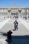A family of tourists take photos in front of the `Palacio Real de Madrid´ Madrid´s Royal Palace in Madrid, Spain. Today, King Juan Carlos of Spain made a public announcement of his abdication will, his son, Prince Felipe of Spain, will become Spain´s king after the official ceremony. June 02, 2013. (ALTERPHOTOS/Victor Blanco)