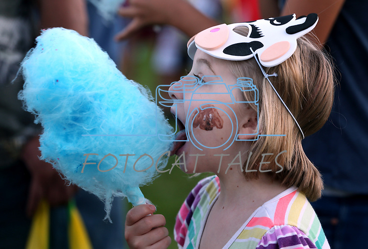 Palin Morgan, 7, enjoys cotton candy during the 14th annual National Night Out in Carson City, Nev., on Tuesday, Aug. 2, 2016. <br />Photo by Cathleen Allison