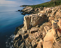 Sunrise light on rock patterns on the shore near Sand Beach; Acadia National Park, ME