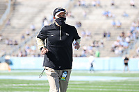 CHAPEL HILL, NC - NOVEMBER 14: Head coach Dave Clawson of Wake Forest jogs off the field after warmups before a game between Wake Forest and North Carolina at Kenan Memorial Stadium on November 14, 2020 in Chapel Hill, North Carolina.