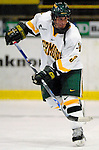 """5 January 2007: University of Vermont forward Peter Lenes from Shelburne, VT, in action against the University of New Hampshire Wildcats at Gutterson Fieldhouse in Burlington, Vermont. The UNH Wildcats defeated the UVM Catamounts 7-1 in front of a record setting 48th consecutive sellout at """"the Gut""""...Mandatory Photo Credit: Ed Wolfstein Photo.<br />"""
