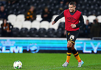 Jake Livermore of Hull City warms up ahead of the Capital One Cup match between Hull City and Swansea City played at the Kingston Communications Stadium, Hull