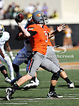 Oklahoma State Cowboys quarterback Brandon Weeden (3) in action during the game between the Baylor Bears and the Oklahoma State Cowboys at the Boone Pickens Stadium in Stillwater, OK. Oklahoma State defeats Baylor 59 to 24.