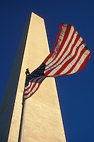 AJ2264, Washington Monument, Washington, DC, flag, District of Columbia, The U.S. Flag flies in front of the towering Washington Monument in Washington, D.C. the Capital City of the United States.