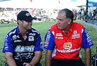 Sept. 23, 2012; Ennis, TX, USA: NHRA funny car driver Matt Hagan (left) talks with Johnny Gray during the Fall Nationals at the Texas Motorplex. Mandatory Credit: Mark J. Rebilas-