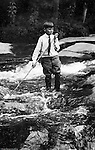 Stewart Township:  View of Homer Stewart Jr playing with a stick in Bear Run Creek with his Sunday school clothes.  Stewart family went to visit Brady family relatives that lived in Stewart Township.
