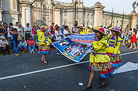 Lima, Peru.  Andean Cultural Parade, Plaza de Armas.  Presidential Palace in Background.
