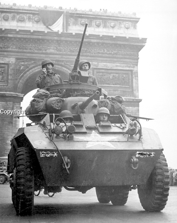 """""""We couldn't stick around long though.  The Jerries were on the run and we wanted to keep them that way.  The Tricolor flying from the Arc de Triomphe looked pretty good as we went through.""""  American tank in Paris, August 1944.  (OWI)<br /> Exact Date Shot Unknown<br /> NARA FILE #:  208-YE-68<br /> WAR & CONFLICT BOOK #:  1051"""