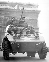 """We couldn't stick around long though.  The Jerries were on the run and we wanted to keep them that way.  The Tricolor flying from the Arc de Triomphe looked pretty good as we went through.""  American tank in Paris, August 1944.  (OWI)<br /> Exact Date Shot Unknown<br /> NARA FILE #:  208-YE-68<br /> WAR & CONFLICT BOOK #:  1051"