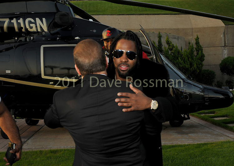 """Tilman Fertitta welcomes Jason Derulo before at the San Luis Salute """"Space Pirates"""" VIP reception Friday February 24,2017. (Dave Rossman Photo)"""