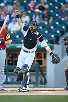 Charlotte Knights catcher Zack Collins (8) follows through on a throw to second base during the game against the Toledo Mud Hens at BB&T BallPark on April 23, 2019 in Charlotte, North Carolina. The Knights defeated the Mud Hens 11-9 in 10 innings. (Brian Westerholt/Four Seam Images)