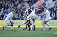 Sean Cox of London Irish is tackled by Netani Talei of Harlequins during the Aviva Premiership Rugby match between Harlequins and London Irish at The Twickenham Stoop on Saturday 7th March 2015 (Photo by Rob Munro)