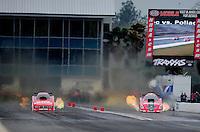 Mar. 11, 2012; Gainesville, FL, USA; NHRA funny car driver Johnny Gray (left) races alongside Cruz Pedregon during the Gatornationals at Auto Plus Raceway at Gainesville. Mandatory Credit: Mark J. Rebilas-
